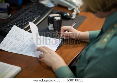 MOSCOW - FEB 28: Women in uniform signs a document in Kiev customs house on February 28, 2013 in Moscow, Russia.