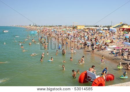 Many People Relaxing On The Beach