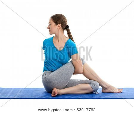 Yoga - young beautiful woman yoga instructor doing  Half Spinal Twist Pose (or Half Lord of the Fishes Pose - ardha matsyendrasana) exercise isolated on white background poster