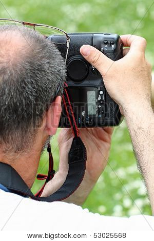 Professional Photographer With Slr From Behind