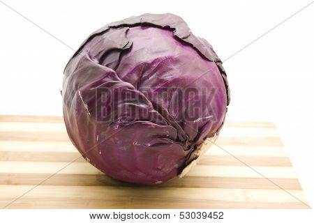 Fresh Raw Red Cabbage on Edge board