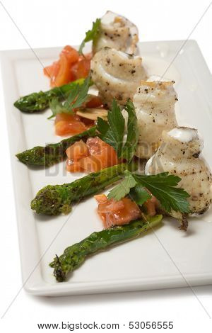 Rolled plaice fillet with asparagus and tomato concasse.