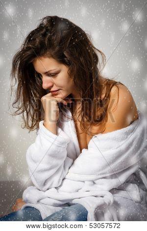 Winter depression: sad young woman