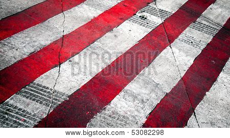 Road Background With Crossing Of Red White Road Marking And Tires Track