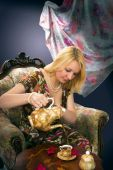 Beautiful rich lady drinking tea in luxury room poster