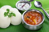 idli, sambar and coconut chutney, south indian breakfast on banana leaf poster