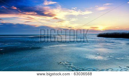 Landscape In Winter From A Froze Lake