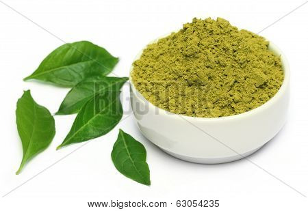 Henna Leaves With Powder On Ceramic Bowl