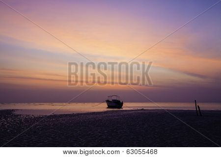 Orange Predawn Skies And A Stranded Lone Boat