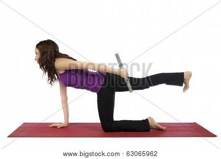 Fitness Woman Doing Kneeling Triceps Kickback