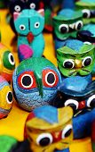 Colorful wooden animal toys - shallow DOF poster