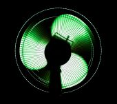 big office fan in green light isolated on black poster