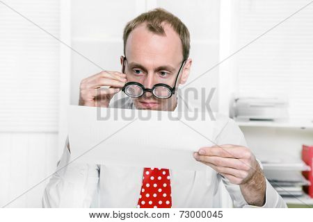 Tax consultant is controlling business numbers with big glasses also like a controller or examiner for tax but funny.