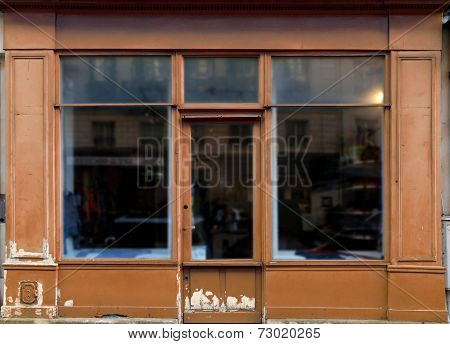 Old brown shop in Paris with lots of copy space