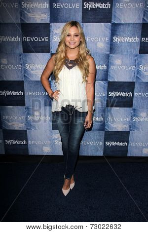 LOS ANGELES - SEP 18:  Olivia Holt at the People Stylewatch Hosts Hollywood Denim Party at The Line on September 18, 2014 in Los Angeles, CA