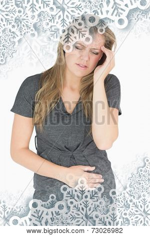 Composite image of sick woman feeling bad against snowflakes on silver