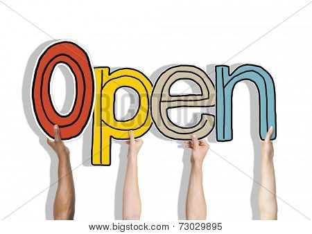 Multiethnic Group of Hands Holding Word Open