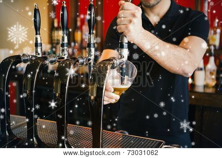 Composite image of Barkeeper pulling a pint of beer against snow falling