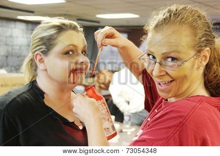 MUSKOGEE, OK - Sept. 13: Actors get make-up to look like zombies for the Castle Zombie Run at the Castle of Muskogee in Muskogee, OK on September 13, 2014.
