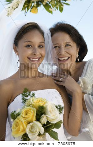 Bride and mother with bouquet