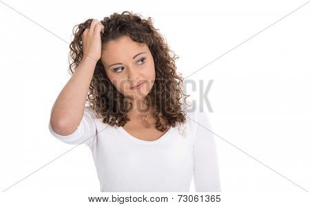 Isolated young woman doubtful or has migraine or other problems.
