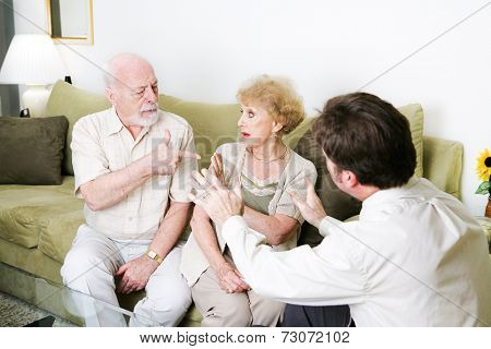 Senior couple arguing in a counseling session.  Copyspace for text.