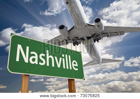 Nashville Green Road Sign and Airplane Above with Dramatic Blue Sky and Clouds.