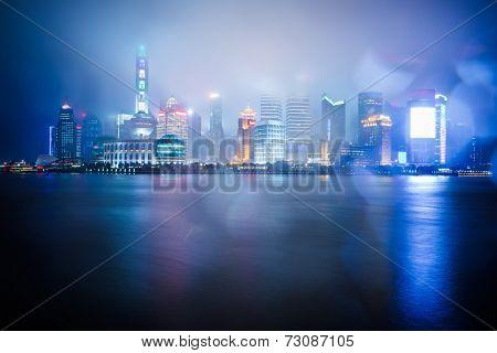 night view at shanghai china, huangpu river and bund.blur in the rain.