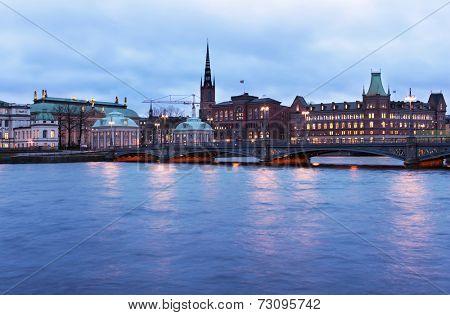 STOCKHOLM, SWEDEN - JANUARY 4, 2011: View to the Vasabron bridge against Riddarholmen in evening. Built in 1878, the bridge is named after King Gustav Vasa