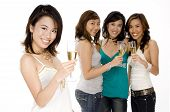 A pretty young asian woman drinks champagne with friends stood behind poster