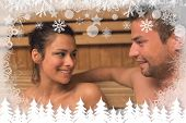 Cheerful couple relaxing in a sauna and chatting against fir tree forest and snowflakes poster