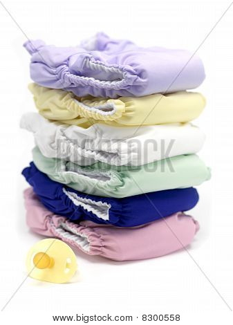 A stack of modern cloth nappies isolated against a white background poster