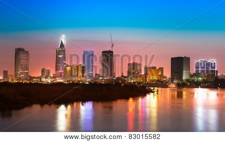 Saigon skyline with river after sunset, Vietnam
