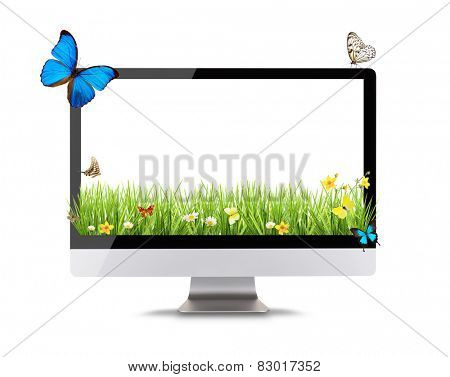 Modern computer display with spring meadow and butterflies. Concept of spring shopping and technology. Front view. Isolated on white background