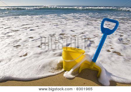 Spade,bucket And Waves