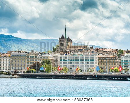GENEVA, SWITZERLAND - MAY 11: Old town cathedral and waterfront luxury brand offices in Geneva, Switzerland on May 11, 2014.