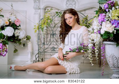 Young spring fashion woman in spring lux vintage interior. Springtime. Trendy girl on a luxury spring background. Allergic to pollen of flowers. Spring allergy  poster