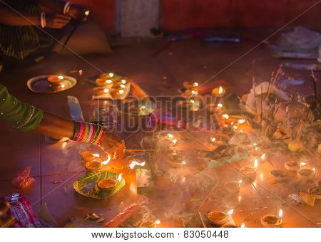 Hindu devotee lighting incense stick
