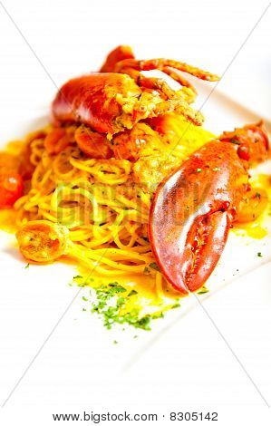 colourful lobster with spaghetti on white plate poster