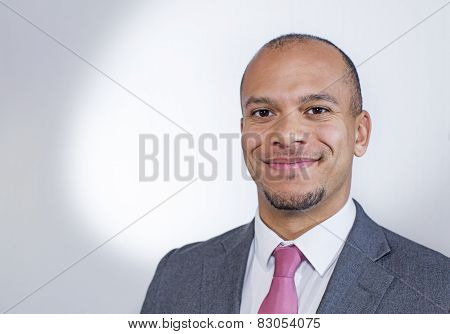 Mixed race businessman smiling to camera