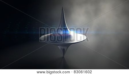 Die Cast Spinning Top Silhouetted