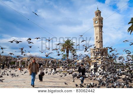 Doves Flying Near The Historical Clock Tower, Izmir, Turkey