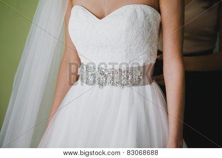 Fragment of wedding dress with belt decorated rhinestones
