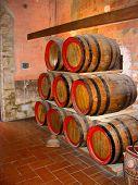 Oak barrels in a wine cellar in Tuscany poster