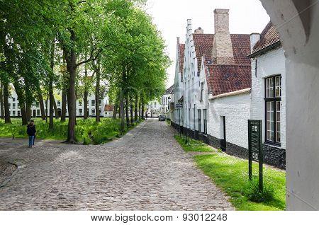 Bruges, Belgium - May 11, 2015: People Visit White Houses In The Beguinage (begijnhof) In Bruges