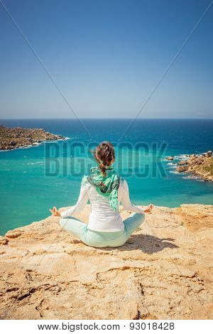 Girl In A Meditation Pose At The Coast