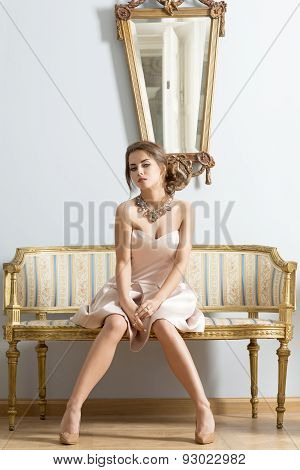 Aristocratic Female On Sofa