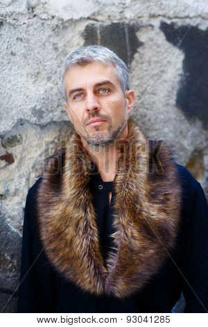 Portrait Of A Sexy Man In Wolf  Fur And Thoughtful Expression On His Face, A  Structure Wall On Back