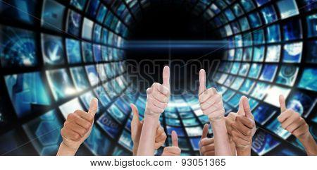Thumbsup against vortex of digital screens in blue