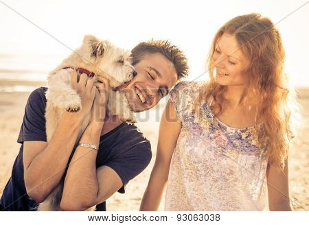 Couple Walking With Dog Outdoor